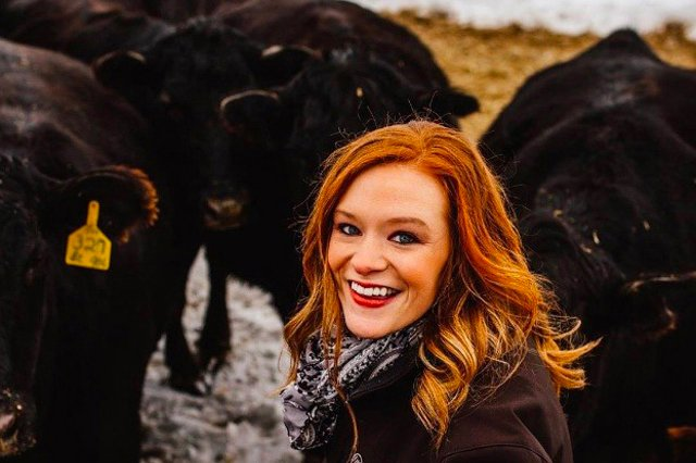 The Vital Science podcast episode 07 logo is a photo of a smiling Jaci with a herd of angus cows.