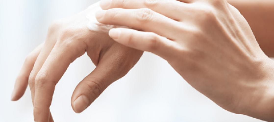 applying lotion to hands
